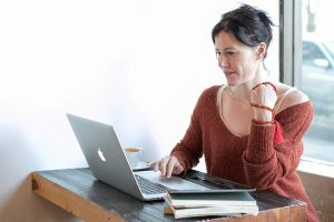 a woman trying online dating on her laptop